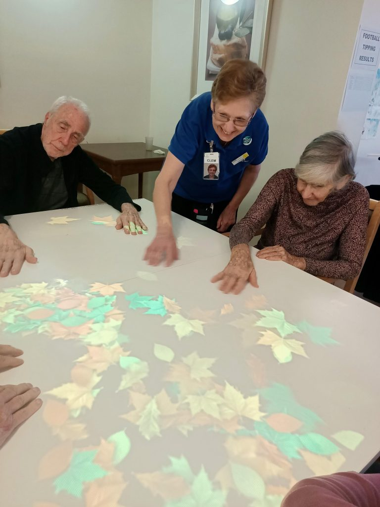 staff and residents using the tovertafel at North Adelaide